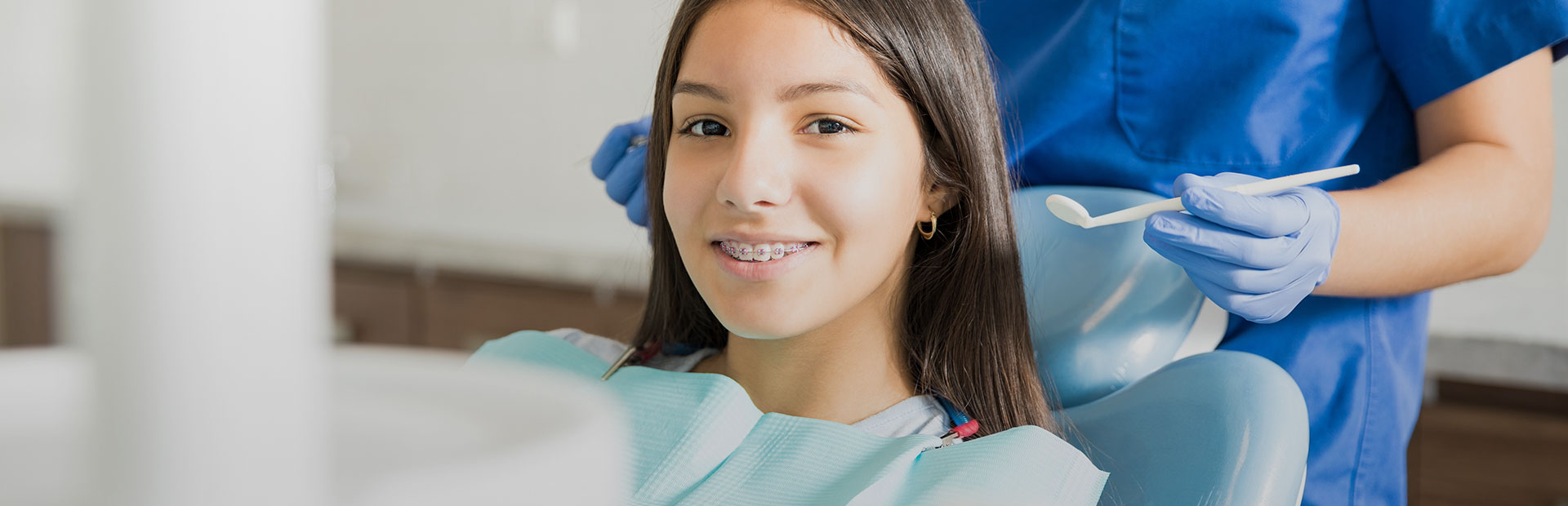 Girl smiling at the dental